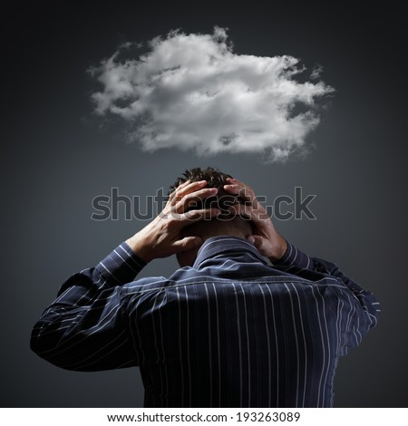Stress, depression and despair - gloomy storm cloud above mans head - stock photo