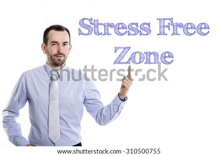 Stress Free Zone - Young businessman with small beard pointing up in blue shirt
