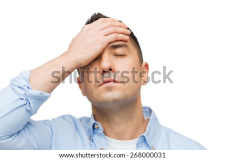 stress, headache, health care and people concept - unhappy man with closed eyes touching his forehead - stock photo