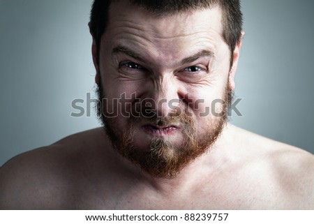 Stress or constipation concept - man with funny grimace - stock photo