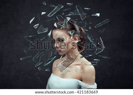 Stress - woman stressed with headache. Female stressed and worried with migraine headache pain. ?oncept with young female model on dark background.  - stock photo