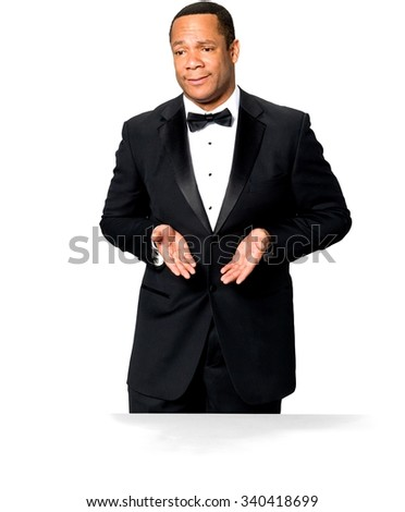 Stressed African man with short black hair in evening outfit pointing using palm - Isolated