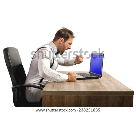 Stressed and angry businessman work at laptop - stock photo