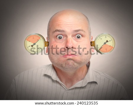 Stressed and overworked businessman under pressure. Mental health concept. - stock photo