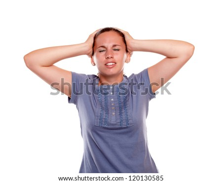 Stressed and tired young female with headache on blue blouse on isolated background - stock photo