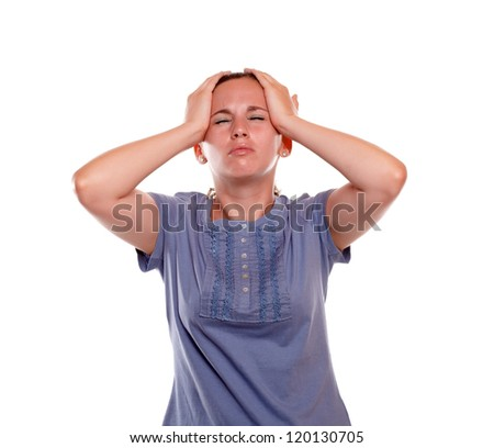 Stressed and tired young woman with headache on blue blouse on isolated background - stock photo