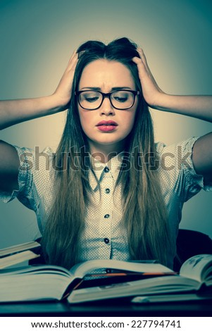 Stressed asian caucasian woman student learning in tons of books isolated - stock photo