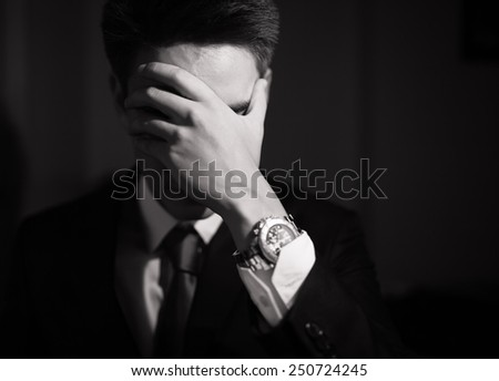 Stressed business man - stock photo