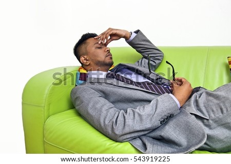 Stressed business man holding the bridge of his nose
