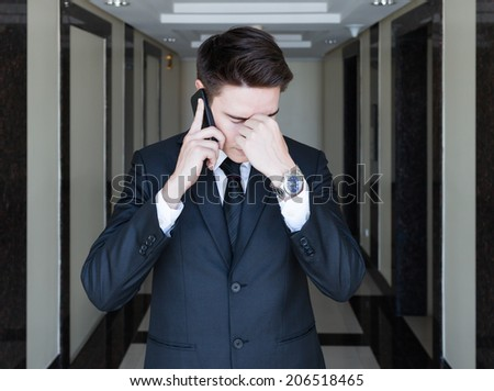 Stressed business man talking on the phone. - stock photo