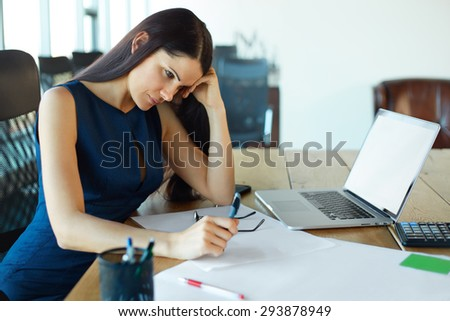Stressed business woman at her working place. Business People   - stock photo