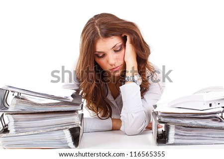 Stressed business woman sitting behind the desk - stock photo