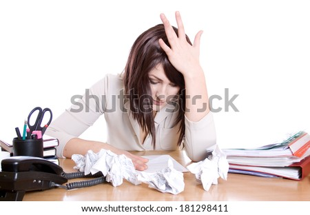 Stressed business woman with stack of paperwork, pile of crumpled papers isolated - stock photo