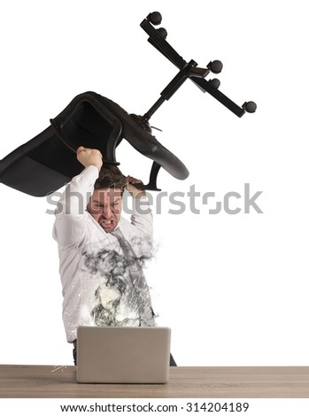 Stressed businessman breaks the computer with chair - stock photo