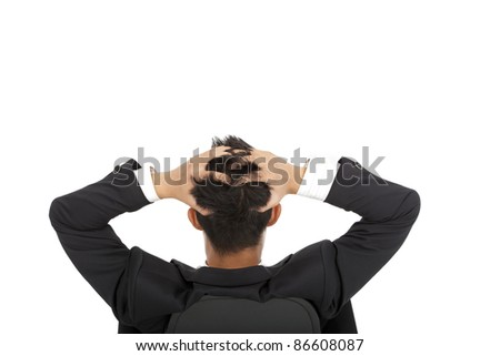 Stressed businessman holding head and sitting on the chair