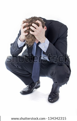 Stressed businessman in suit hands in his hair - stock photo