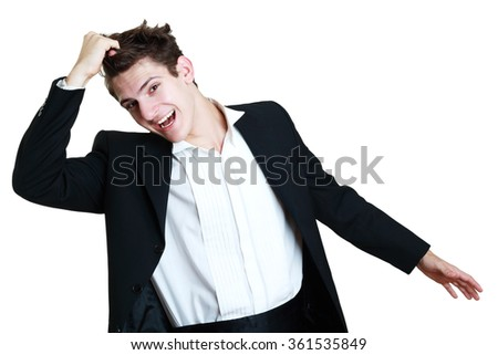 Stressed businessman in suit pulling hair out - stock photo