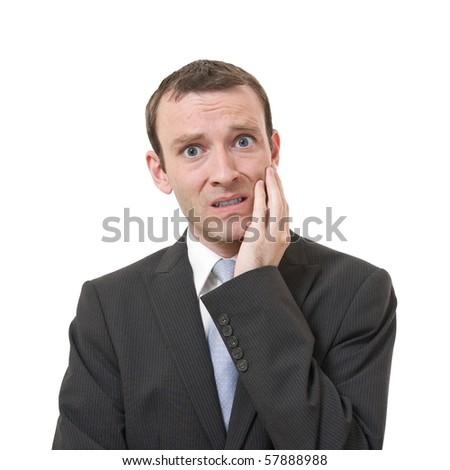 stressed businessman isolated on white background - stock photo