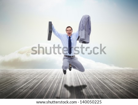Stressed businessman jumping over wooden boards leading out to the horizon - stock photo