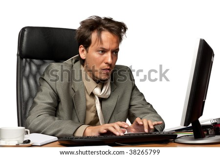 Stressed businessman looking at computer on a white background - stock photo