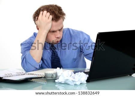 Stressed businessman making no progress - stock photo