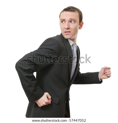 stressed businessman running away looking back - stock photo