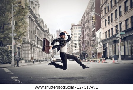 stressed businessman runs through the city - stock photo