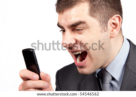 stressed businessman screaming in telephone - stock photo