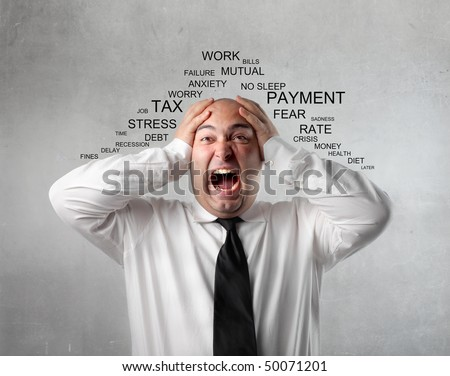 Stressed businessman shouting - stock photo
