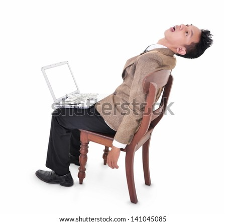 Stressed businessman sleeping with a laptop, isolated on white background - stock photo