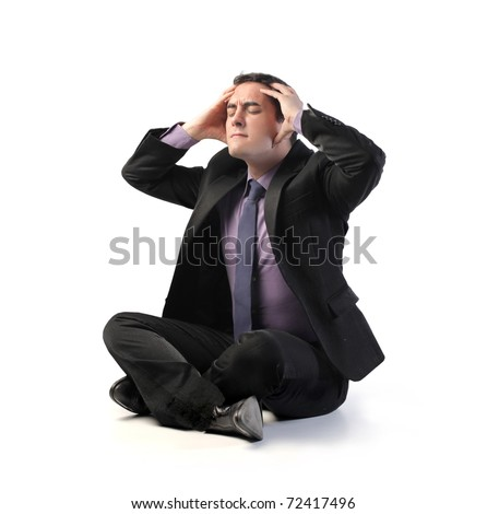 Stressed businessman suffering from headache - stock photo