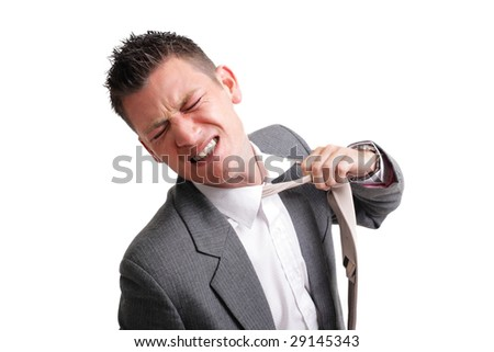 stressed businessman tearing his tie off. isolated over white background - stock photo