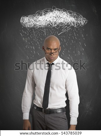 Stressed businessman with drawing of cloud and rain - stock photo