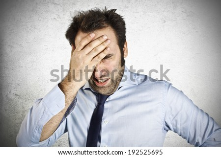 Stressed businessman with hand on the head  - stock photo