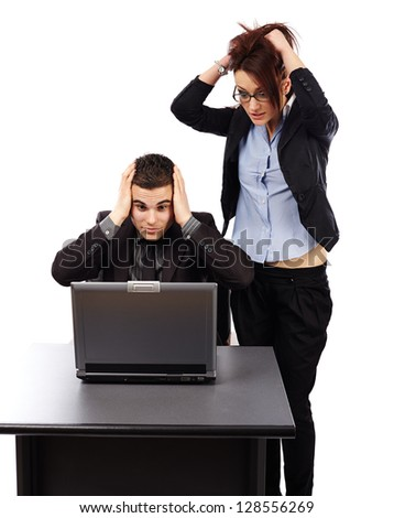Stressed businesspeople having problems with their laptop - stock photo