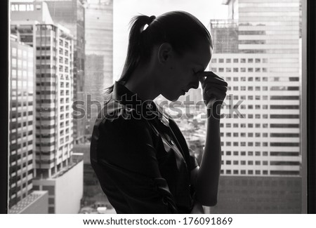 Stressed businesswoman - stock photo