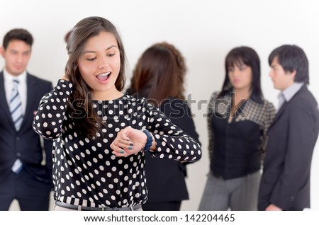 stressed businesswoman checking the time, group shot - stock photo