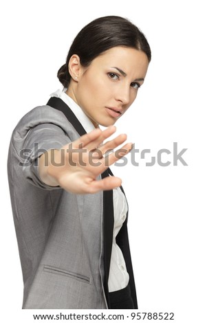 Stressed businesswoman making stop sign on white background, focus on business woman.