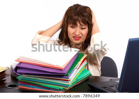 Stressed businesswoman on her office desk