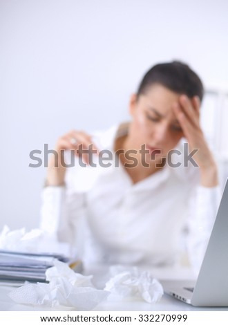 Stressed businesswoman sitting at desk in the office