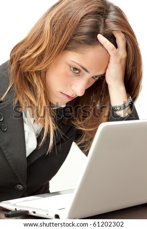 Stressed businesswoman working at her notebook - stock photo