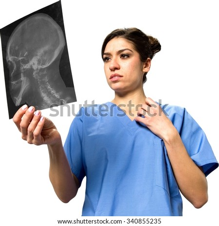 Stressed Caucasian young woman dark brown in uniform holding x-ray - Isolated - stock photo