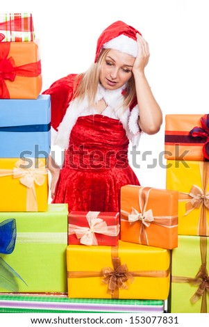 Stressed Christmas woman with many presents, isolated on white background.