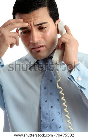 Stressed, depressed, worried or upset business man using telephone.  Useful for many situations.  White background. - stock photo