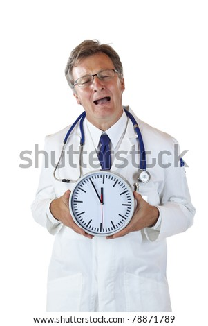 Stressed doctor with clock in front cries because of time pressure. Isolated on white background. - stock photo
