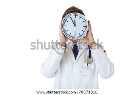 Stressed doctor with clock in front of face as sign of time pressure.Isolated on white background. - stock photo