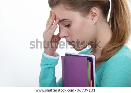 Stressed female teenager worried about exams - stock photo