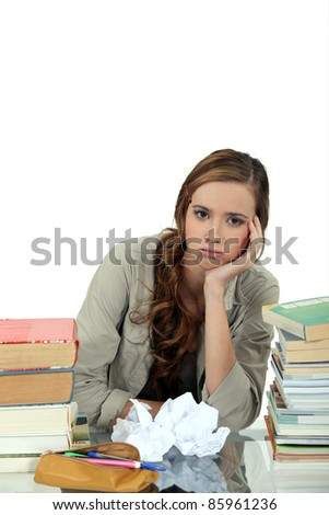 Stressed girl revising - stock photo