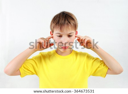 Stressed Kid cover the Ears on the White Background