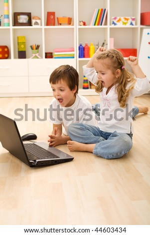 Stressed kids about to win online game - technology addict generation - stock photo